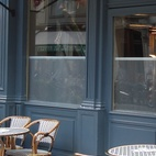 Hotel Jules is located in a limestone building that dates from 1860. The exterior is painted a glossy blue-black color—a custom hue that Auer says was inspired by his favorite Prada shirt. The classic rattan bistro tables and chairs are from the local company Drucker, the oldest rattan chair manufacturer in the world, founded in 1885.