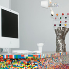 The idea for Simon Pillard and Philippe Rossetti's Lego kitchen in Paris sprouted five years ago, when Pillard put 500 blocks and a day's worth of work into building a Lego-legged chair. The designing duo—who create products together under the name Munchausen—recently gave the seat a colorful companion. They covered their kitchen island—a simple wooden block—with 20,000 Lego pieces. Photo by Céline Clanet