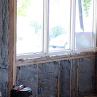 "Creating a well-insulated envelope was another key design feature. The home is insulated with cotton batting made mostly of recycled blue jeans in the walls and cell foam in the ceiling, which expands to fit into irregular spaces where the batting can't. ""The roof has an R-value of 42-45,"" says Ian."