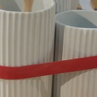 Also at Eno: these ceramic kitchen canisters, shaped like gears and bound together with a thick red rubber band.