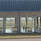 In 1986 Judd parted ways with DIA and the Chinati Foundation was born. Here we see one of two artillery sheds that Judd rehabbed with a new Quonset-style roof and new quartered windows—additions that doubled the proportions of both structures and provided a light-filled space for his 100 milled-aluminum works.