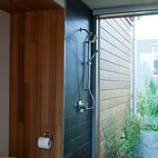 Here's the bathroom. Water flows through the floor into a series of constructed wetlands that filer the water for future non-potable uses. The ceramic tile is by Emil America.  Courtesy of: Foto©Jim Tetro/Jim Tetro Photog
