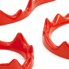 We love these sand-cast powder-coated aluminum Fuego Lento trivets, designed by Liliana Ovalle ($125). You get three and they can nest inside each other.  Courtesy of © MoMA 2011.