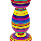 The colorful Pirueta Table ($750) is made of hand-painted and enameled Mexican white pine and inspired by children's toys. The designers are Paulina Gonzalez-Ortega and Andres Ocejo.  Courtesy of © MoMA 2011.
