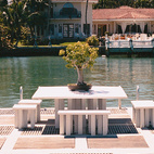 A pier at the private Hochberg residence typifies Miami's complete embrace of the outdoors during the warm spring months.  Photo by: Roy Zipstein