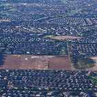 Countless housing developments crowd the periphery of the area's remaining farmland. The developments are broken up into self-contained units. Typical to sprawl, the work and service sectors are accessible only via highway.