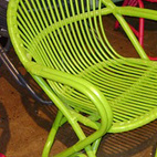 A day-glo set of chairs exhibited at the 2011 IDS Toronto.