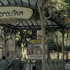 """Three stations today still boast Guimard's fan-shaped glass awnings, called édicules, as shown here at the Abbesses station in Montmartre. Photo courtesy of """"rwb"""
