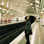 Most stations have column-free vaulting with elliptical shaped walls, about 46 feet wide across the tracks and 19 feet high. The walls are lined with white bevelled tiles to reflect ambient light, and enameled nameplates up to six to eight meters long, emblazoned with the name of the station. The style and colors of the wall decor have transformed based on designers' tastes over the decades, and we can see remnants of each successive renovation program - from the dark green carrossage metal paneling at Parmentier, the flat, 1960s cafeteria-orange tiles at Oberkampf, use of colored light filters on the ceiling at Stalingrad, polished bare concrete at Meteor, and now, a slow return back to the bevelled white tiles. Photo courtesy of