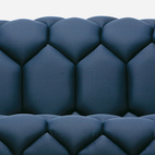 The soft, bowl-shaped seat of this sofa was designed by the Bouroullec Brothers. With a fiberglass shell, steel frame, and foam inserts, you may sink into the couch, but you won't drown.    This originally appeared in Six More Modern Sofas.