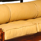Brazilian modernist Sergio Rodriguesmade a Tonico sofa in the 1960s, also of jacaranda and leather. Photo courtesy Noho Modern    This originally appeared in Sergio Rodrigues.