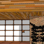 Domoor Carport Submitted by: Name not provided Designer's Description: The challenge was to take a cluttered entry carport from an original Frank Lloyd Wright home and make it more welcoming. We wanted a partition that would hide the storage area and lead guests to the main entry. An overhead garage door wouldn't work because the ceiling height was only six feet. We also wanted something easy to use, because we needed regular access to the carport and the laundry room beyond. The door also had to be remove-able, so the historic structure would not be compromised. Essentially a combination of two doors, it's made up of a regular in-swing door for normal access to the storage, which shuts against an out-and-up swinging panel that provides occasional access for a vehicle. When closed, it screens the storage area from view and makes a dramatic backdrop to the entrance. At night, it provides the soft glow of a Shoji screen when lit from behind.