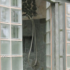 """Operable Glass Block French Doors Submitted by: B-green Homes Designer's Description: I am a green homebuilder and want to share with Dwell readers a unique, operable glass-block exterior door that I built and installed in the shower area of my """"Boomerang"""" house in the mountains of Costa Rica. Based on a very robust 180-year-old French door mechanism,  my version combines sturdy technology with modern glass-block, making what I believe to be the world's only operable glass block double-door."""