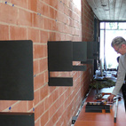 Since the mounting had to be perfect, we hired an expert cabinetmaker, T.K. Smith, to complete the bracket installation.