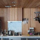 When we first moved here, the kitchen was already established as a U-shaped counter that extended the original Craig Ellwood design. I am a big supporter of removing upper cabinets and having open shelving and space instead. However, this means that everything you'd normally hide in your cabinet is now on display. The benefit of this strategy is that you eliminate anything that you absolutely don't use or want. Everything has to be reduced down to essentials.