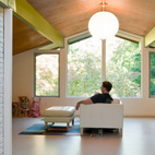 """In 1956 in Tuxedo Park, New York, architect Carl Koch, a prefab pioneer, erected one of his earliest """"Techbuilt Houses,"""" a 2,400-square-foot four-bedroom home constructed largely from standardized four-by-eight-foot modules attached to a post-and-beam frame. Architects Gilles Depardon and Kathryn Ogawa recently completed the house's renovation. On the second floor, the architects maintained the existing exposed post-and-beam structure but exchanged the original furniture-grade Luan mahogany ceiling for a stained birch plywood. Photo by Carl Bellavia.  Photo by: Carl Bellavia"""