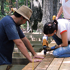 Students lay down cedar planks in preparation for the amphitheater.