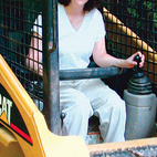 Laura Terry leads the charge in her Caterpillar tractor.