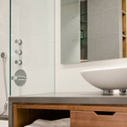 The bathroom features fixtures by Duravit and Hansgrohe.