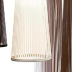 SOLIS LAMP When the light filters through the laser-cut streams under the various shades of earth tones it creates a radiating pattern resembling the sun's rays, making the resulting shadow as much a part of the fixture as the structure itself.