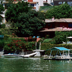 Now home to a hillside resort town, the lake of Valle de Bravo was formed in 1946, in one of president Miguel Alemán's hydroelectric dam projects. Casa Ia was named for the architect's first child and planned with lake views as a primary objective.  Photo by: Paco Perez / Alluro