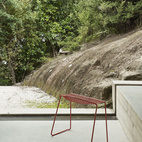 The rock slope just outside is in clear sympathy with the concrete cant inside—nature right alongside architecture.  Photo by: Matthew WilliamsCourtesy of: matthew williams