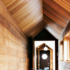 Richly hued cedar lines the corridor of a house on the Magdalen Islands in Quebec, Canada. Photo by Matthew Monteith.  Photo by Matthew Monteith.   This originally appeared in Blue in the Facade.