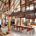 """We didn't want to diminish the openness and height and feeling of a great expanse of space,"" said the owner of this resurrected 19th-century barn house in Pine Plains, New York. Fortunately, the barn frame's horizontal beams perform a domestic function by creating the illusion of a lower ceiling. An abundance of furnishings in rich materials fills out the space. Photo by Raimund Koch.  Photo by: Raimund Koch"