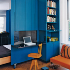 TRUE BLUE A 450-square-foot apartment in the Upper West Side needed to accommodate the resident's working, entertaining, and resting needs, without eating up precious inches. This groovy blue home office offers all three. A perforated steel divider rolls out to allow the office compartment to unfold. Photo by Raimund Koch.  Photo by Raimund Koch.   This originally appeared in Space-Efficient Renovation in New York.