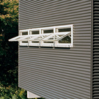 Corrugated siding usually used for roofing is used for the exterior.  Photo by: Linny Morris