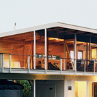 Ipe decking extends from the actual deck to the home's interior.