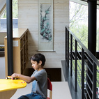 The loft above the living room is Suresh's terrain, given over to toys, books, and a colorful Lego table. The Clerestory windows maximize the natural light in the house—essential since there are only three hours of sun on a typical winter day.