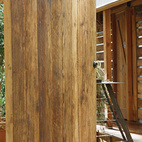 The front door is made from re-milled old leftover beams. A custom pivot mechanism allows the weight of the massive door to rest on a tiny point, allowing for almost friction-free operation.  Photo by: Todd Hido