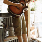 Cody, 17, and Dylan jam in the kitchen with Yogi, the Welsh corgi.  Photo by: Todd Hido