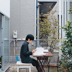 Let's take this outside: One resident of a Tokyo apartment building built by the Office of Ryue Nishizawa takes advantage of fair weather and does away with working inside altogether, utilizing patio space for an inspiring outdoor office. Photo by Dean Kaufman.    Photo by Dean Kaufman.   This originally appeared in Building Blocks.