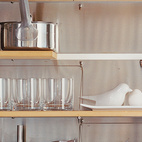 The kitchen shelves are organized with clinical precision.  Photo by Misha Gravenor.