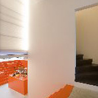 Secluded stairs lead to the home's most private area, the bedrooms on the second level.