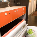 The designer eschewed expensive cabinetry in favor of powder-coated stainless steel, and found the Miele cooktop and oven at a floor sale. To keep things uncluttered, Popp installed a Sub-Zero under-counter refrigerator, a small Fisher & Paykel dishwasher and a simple Hansgrohe faucet, all found at a discount.