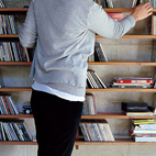 Hernaez organizes CDs on a modular lapacho wood shelf designed by Sticotti.