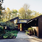 Ben Watson and his partner, Claudio Tschopp, relocated from Basel, Switzerland, to Portland's Pearl District eleven years ago. Surrounded by forests, their small Northwest and mid-century modern-inspired open-plan home, with an emphasis on natural local materials and natural light, was designed in 1972 by local architect Edgar Waehrer.  Photo by: John Clark