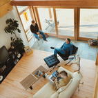 A half floor upstairs overlooks the spacious living area where Bill and his sons relax.