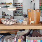 Open shelving between the living room and dining area maximizes light and air flow and showcases eclectic objects, which include old printing blocks found at a garage saleand bowls Tyler's mother boughtin South Africa.  Courtesy of Andrew Meredith 2007.