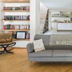 """A Knoll sofa is bracketed by two leather-and-wood Falcon chairs by Sigurd Resell. """"Being in control at every stage of the design and construction process meant I didn't have to compromise on anything,"""" says Kathryn Tyler.  Courtesy of Andrew Meredith 2007."""