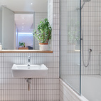 """""""I put everything that I've always loved into this house,"""" says Tyler—and that includes white tiles edged with gray grout in the bathroom, a design move previous clients had balked at.  Courtesy of Andrew Meredith 2007."""