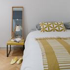A peek inside the master bedroom, with touches of marigold yellow throughout.  Courtesy of Andrew Meredith 2007.