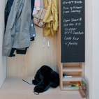 A built-in closet and chalkboard surface in the entry keeps things tidy and the couple's to-do list in order.  Courtesy of Andrew Meredith 2007.