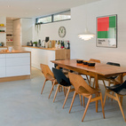A wider look at the open-plan dining room and kitchen.  Courtesy of Andrew Meredith 2007.