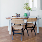 """Mix MethodThe best way to integrate different furniture styles is to treat """"the space like a gallery and place objects according to their colors,"""" Hayon says. He cautions against using too much natural wood furniture in a space with wood floors: """"You need contrast."""" In his home, contrasting materials, small porcelain objects, and an occasional black form enliven a palette of light gray furniture.  Photo by: Nienke Klunder"""