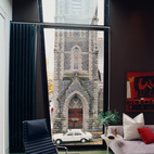 The most dramatic view in the apartment, the First Presbyterian Church looms large in the Kovel living room.  Photo by: John Clark