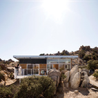 Constructed using corrugated and galvanized steel sheets and located amidst the boulder-strewn landscape of the Mojave Desert, David McAdam's prefab prototype looks like it might have just landed on another planet. Photo by Misha Gravenor.  Photo by Misha Gravenor.   This originally appeared in Plan of Steel.